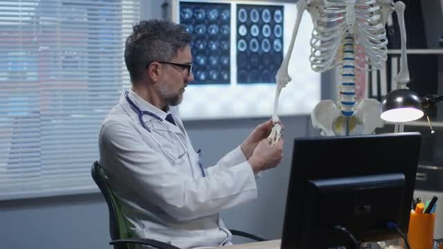 Doctor Using Skeleton Model: Stock Video