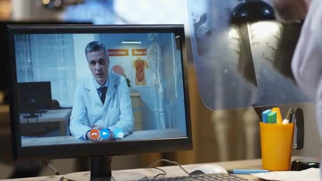 Doctors Have Video Call: Stock Video