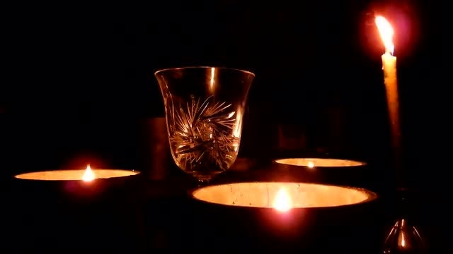 Romantic Candle Flames With Wine Glasses: Stock Video