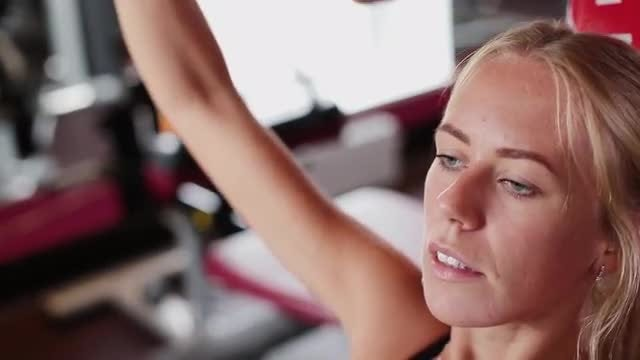 Woman Working Out With Trainer: Stock Video