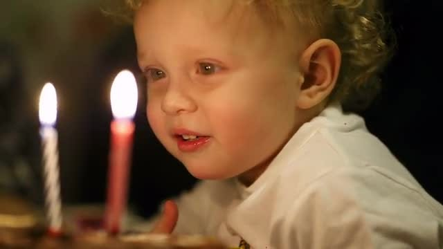 Little Boy Blowing Candles: Stock Video