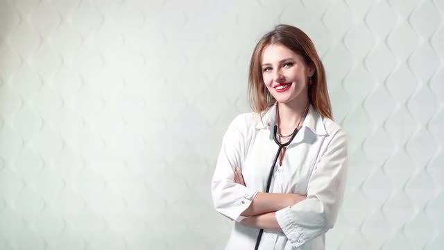 Cute Female Doctor With Stethoscope: Stock Video