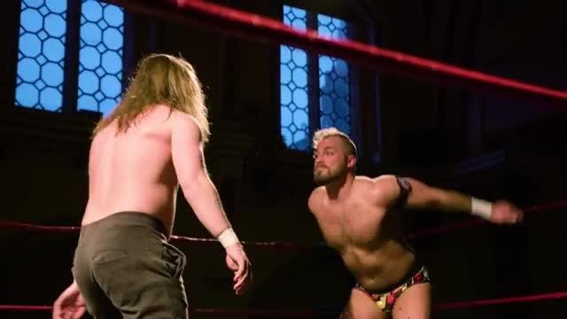 Wrestler Dropkicking Opponent In Face: Stock Video