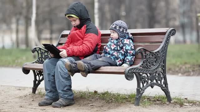 Two Brothers On Park Bench : Stock Video