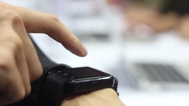 Woman Tries Out Smart Watch: Stock Video