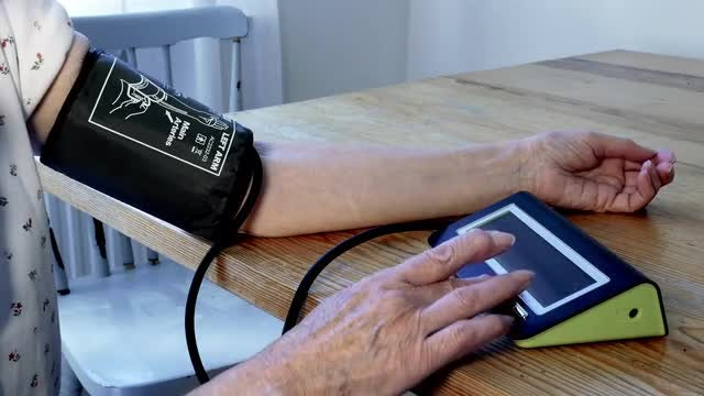 Old Woman Measuring Her BP: Stock Video