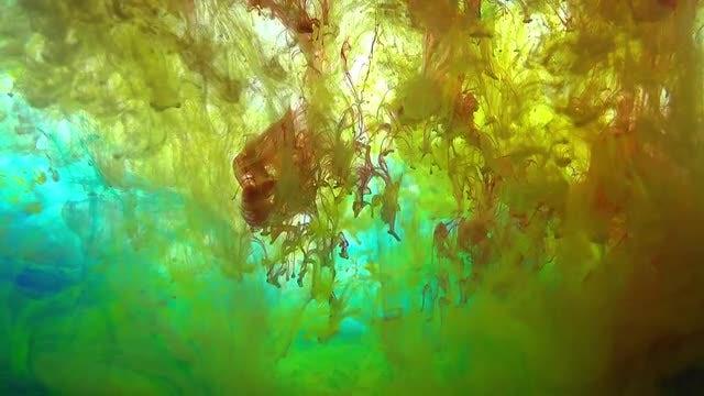 Yellow And Turqouise Paint Swirls: Stock Video
