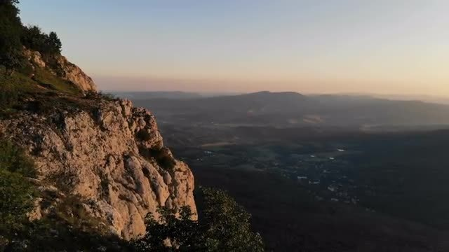 Mountain Cliff And Residential Valley: Stock Video