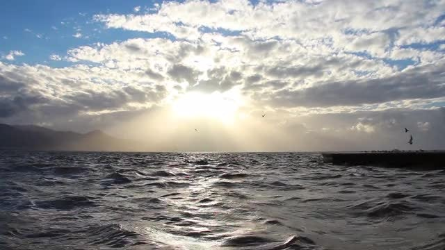 Cloudy Sunset Over Ocean: Stock Video