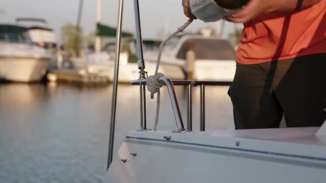 Tying Boat Fender To Boat: Stock Video