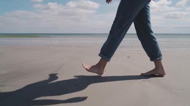 Woman Walking On Beach: Stock Video