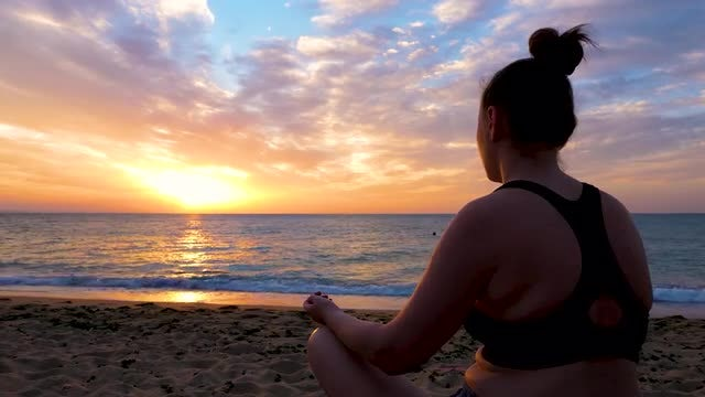 Woman Meditating By The Beach: Stock Video