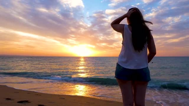 Young Woman Admiring Beautiful Sunset: Stock Video