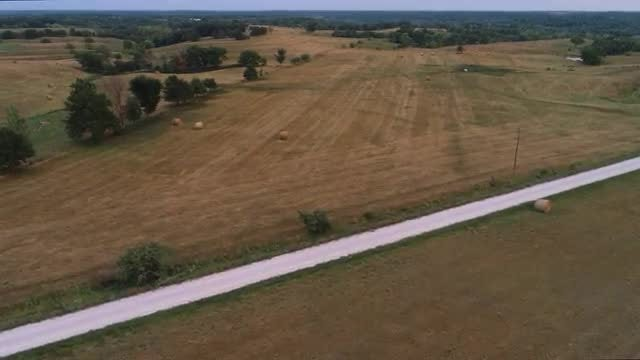 Aerial Shot Of Expansive Hayfield: Stock Video
