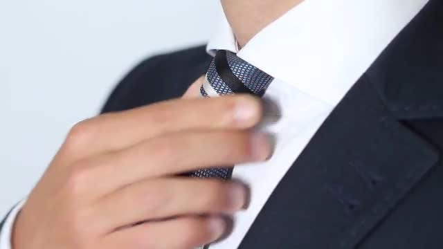 Businessman Adjusting His Tie: Stock Video
