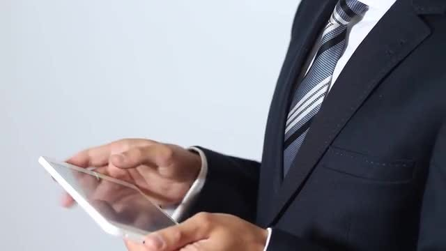 Businessman Using Tablet At Work: Stock Video