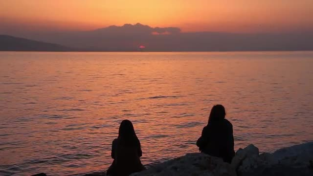 Silhouettes Of Girls On Rocks: Stock Video