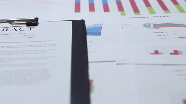 Business Contract And Charts: Stock Video
