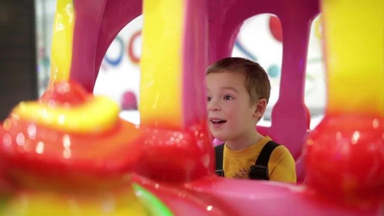 Boy On An Amusement Train: Stock Video