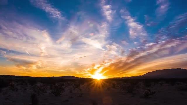 Golden Sunrise Over A Desert: Stock Video