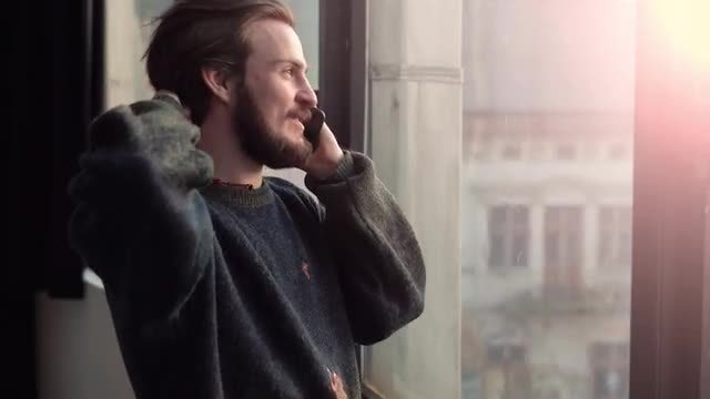 Man Talking On His Smartphone: Stock Video