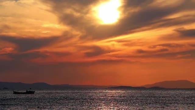 Fishing Boat Sailing At Sunset: Stock Video