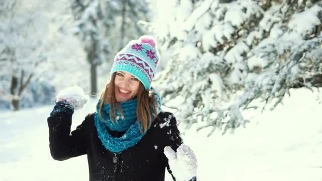Girl Throwing A Snow Ball: Stock Video