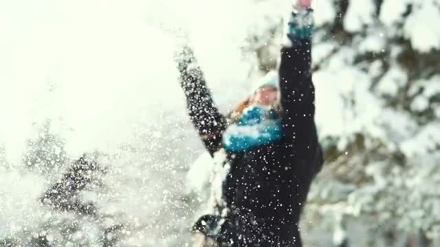 Girl Throwing Snow Over Head: Stock Video