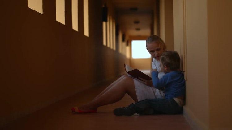 Family Reading In Hotel Corridor: Stock Video