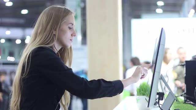 Girl Using Large Touchscreen Monitor: Stock Video