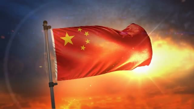 China Flag Backlit At Sunrise: Stock Motion Graphics