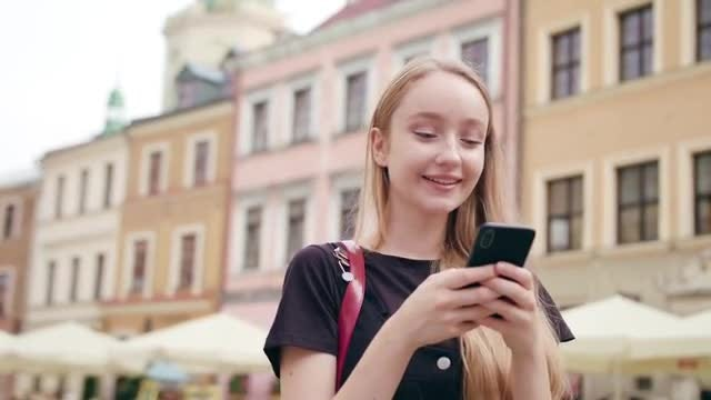 Girl Smiling While Reading Text: Stock Video