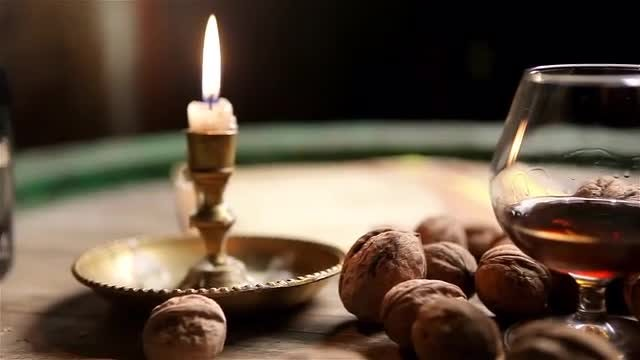 Cognac And Hazelnuts On Table: Stock Video