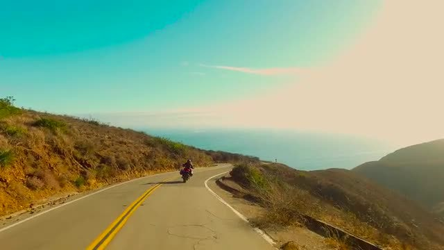 Motorcycle Driving Down California Coast: Stock Video