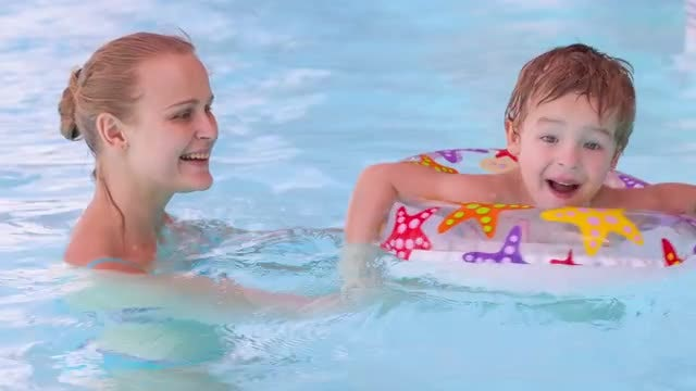 Mother And Son Swimming: Stock Video
