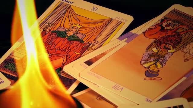 Tarot Cards Rotating Around Fire: Stock Video