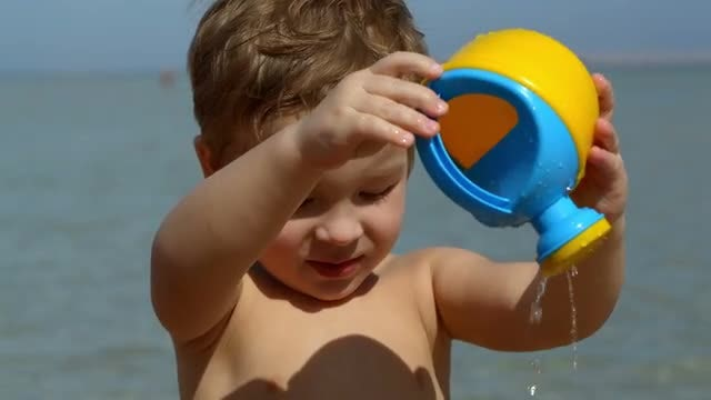 Boy With Beach Toy: Stock Video