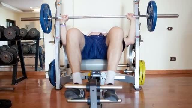 Man Lifting Weights At Home: Stock Video