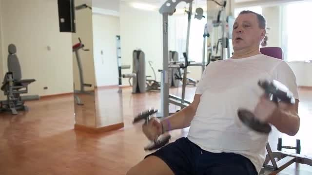 Working Out With Dumbbells: Stock Video