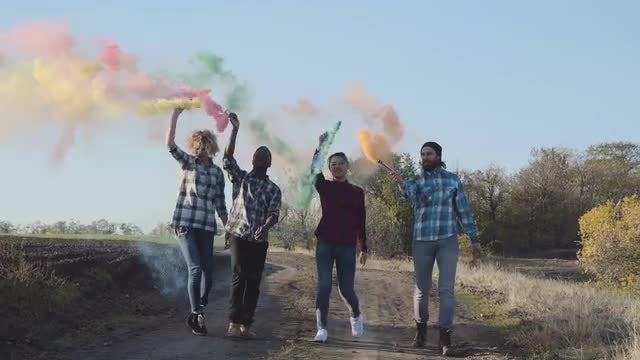 Youth With Colored Smoke Grenades: Stock Video