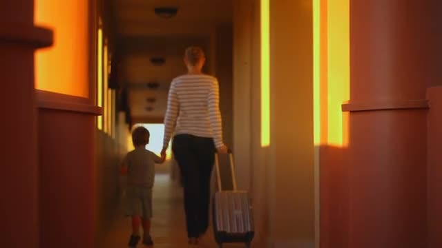 Mother And Son Leaving Hotel: Stock Video