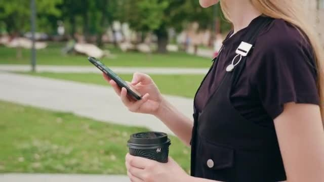 Woman Using Smartphone While Walking: Stock Video