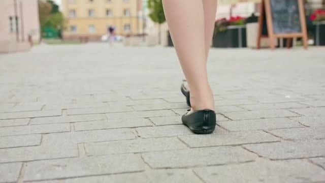 Woman Walking On Pavement: Stock Video