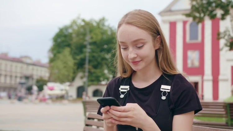 Girl Chatting On Her Smartphone: Stock Video