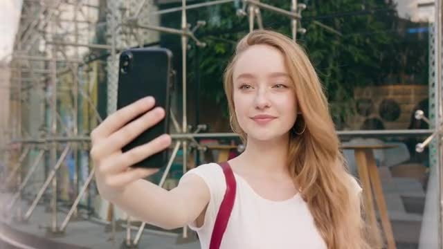 Woman Taking Selfies With Smartphone: Stock Video