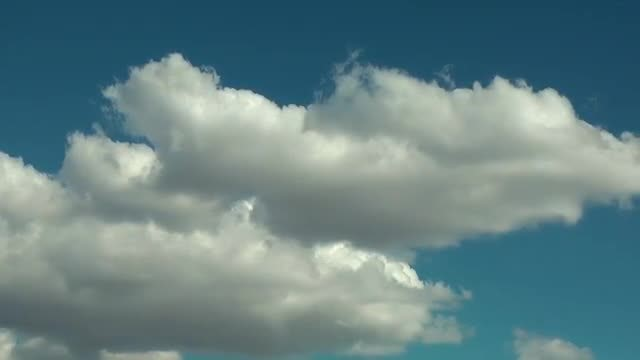 Clouds Moving Under Blue Sky: Stock Video