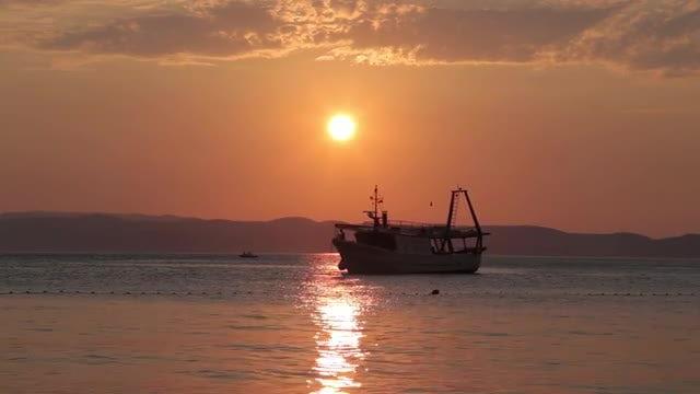 Large Ship Sailing At Sunset: Stock Video