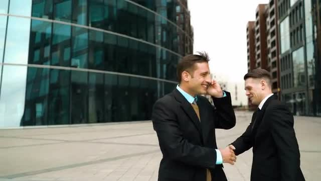 Businessman Talking On Smartphone Outdoors: Stock Video