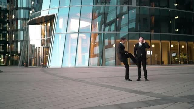 Pulling A Prank On Businessman: Stock Video
