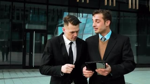 Young Businessmen Using Digital Pad: Stock Video